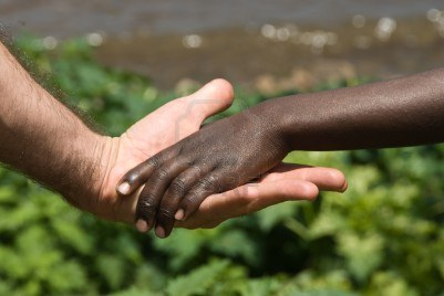 10850230-the-view-of-a-child-s-hand-being-held-by-the-hand-of-an-adult-rwanda
